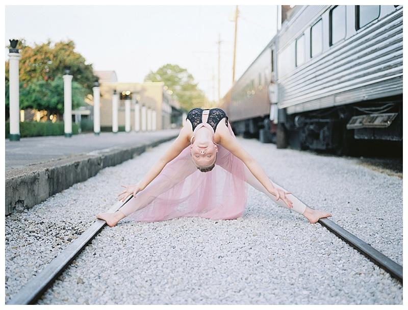 Ballerina on train tracks