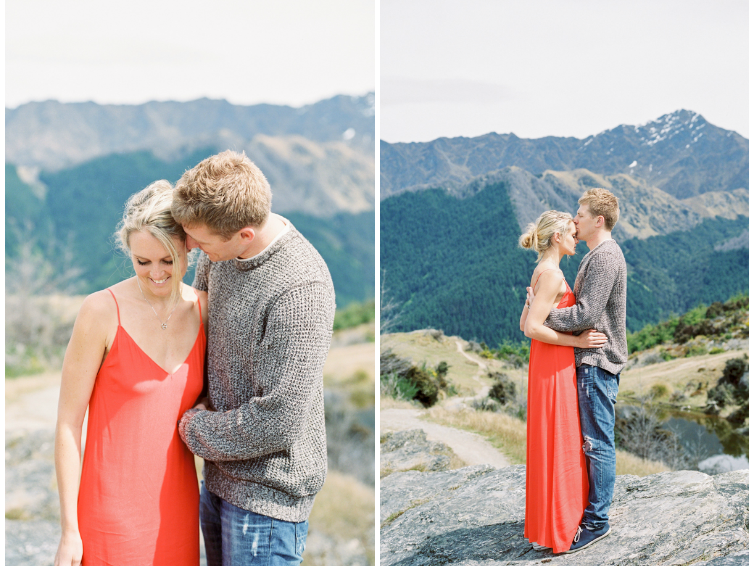 Couple hugging on top of Queenstown Hill in New Zealand Red dress bride