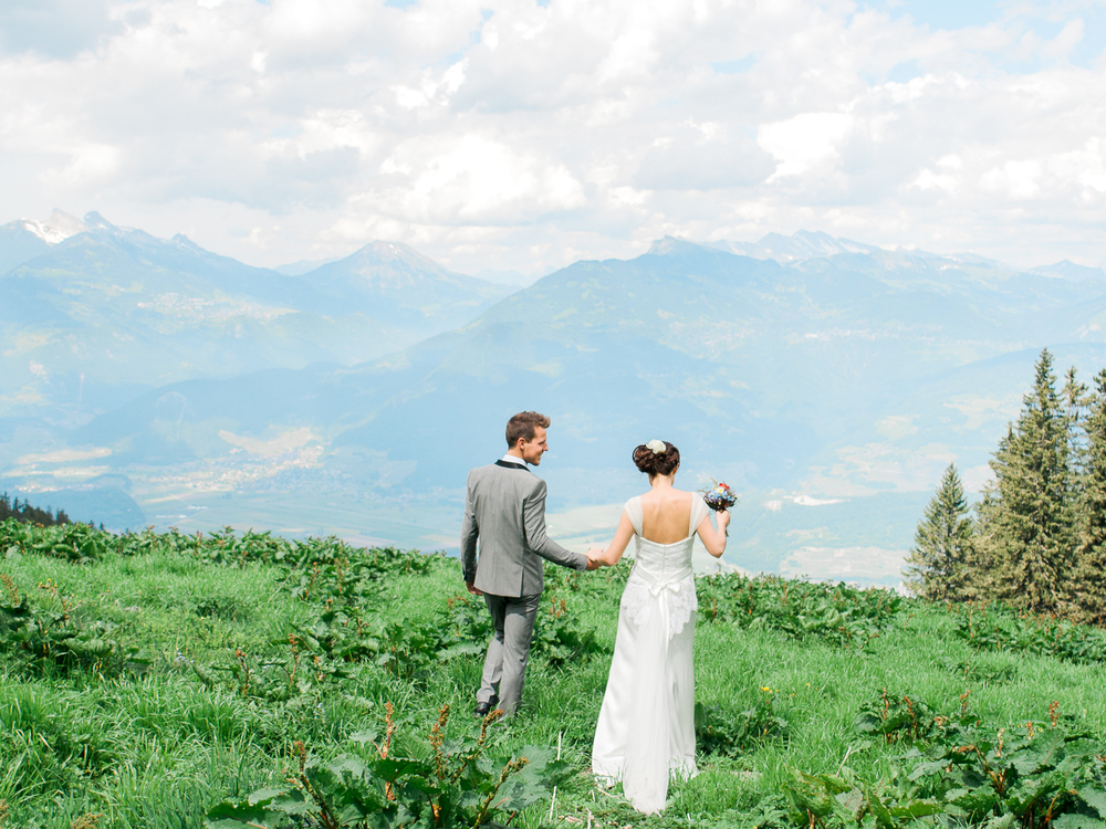Couple walking on top of the mountains in Switzerland
