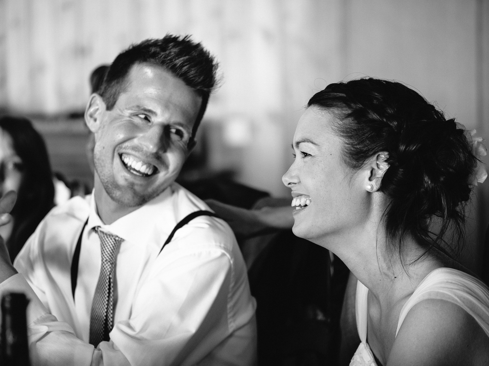 Laughing bride and groom at dinner