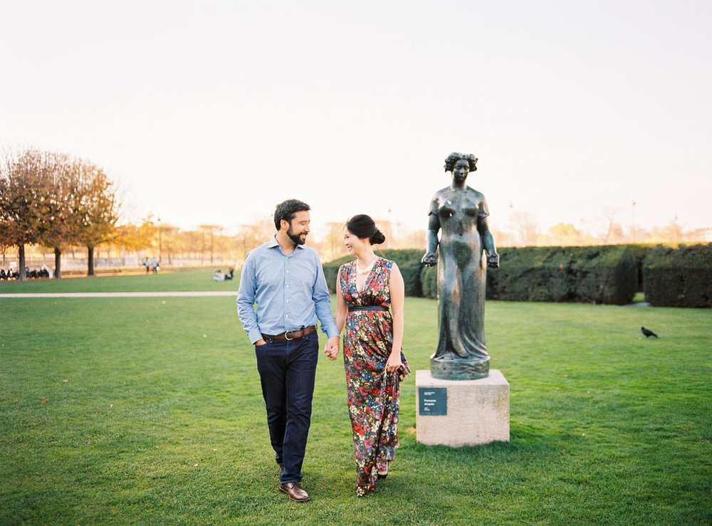 Couple walking in Tuileries Garden in Paris Engagement session