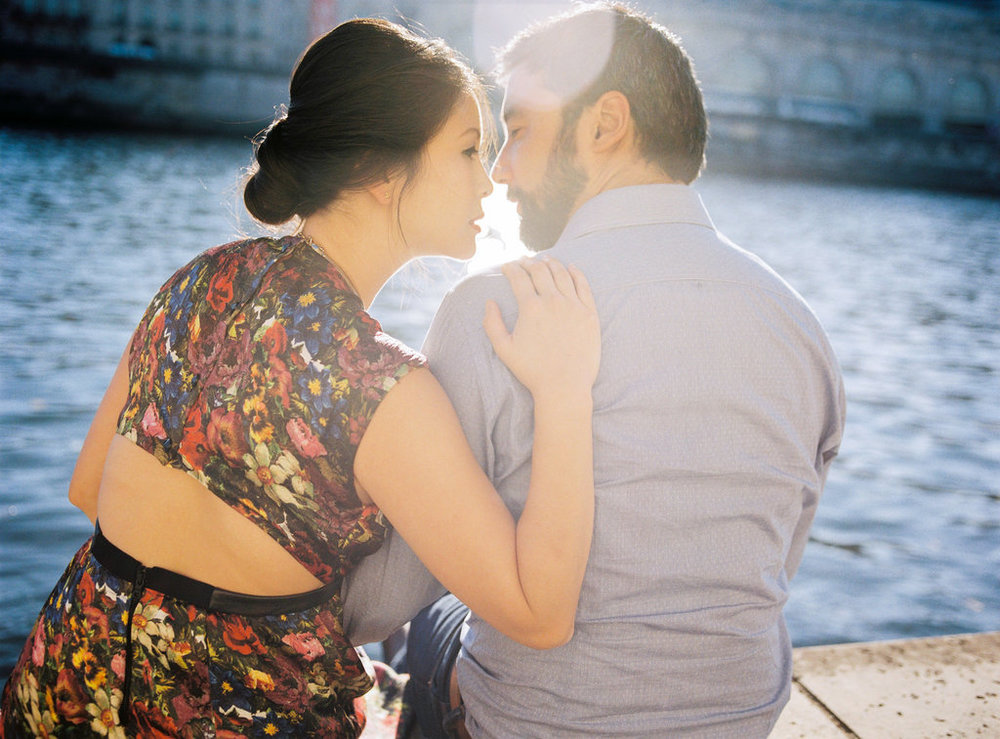 Couple kissing along river La Seine Parisian elopement