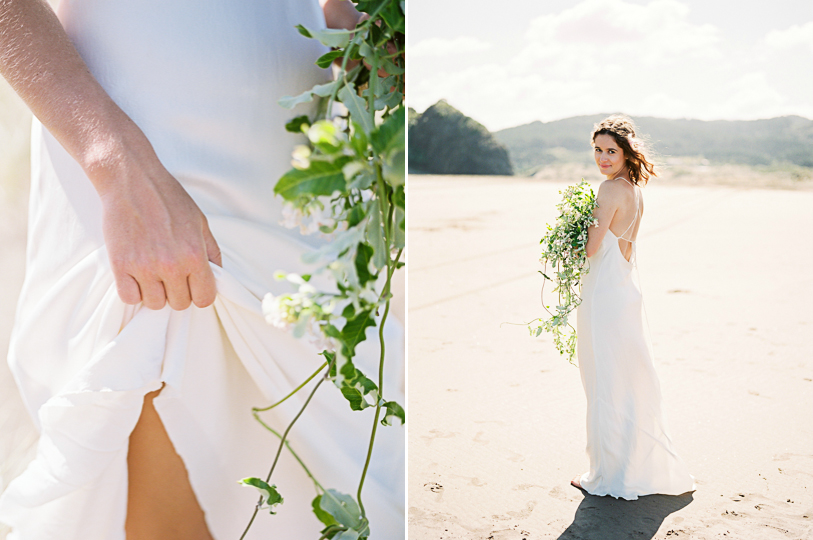 Beautiful barefoot bride holding her wild wedding bouquet in New Zealand beach