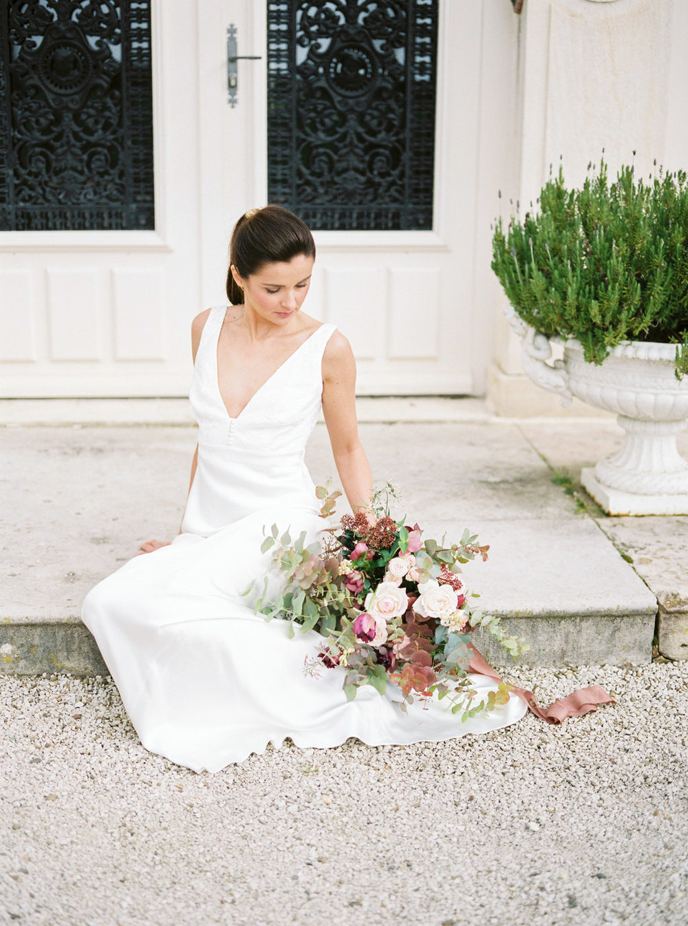 Bride with wedding bouquet wearing Charlie Brear dress
