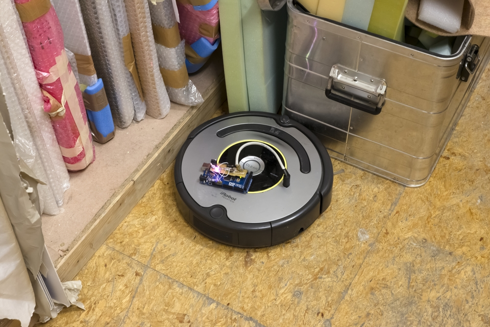 Liudvikas Buklys,  Reprogrammed iRobot Roomba® Vacuum Cleaning Robot,  2015. Installation view  Cartoon Physics,  Kerstin Engholm Gallery, 2015. Photo: Stefan Lux.