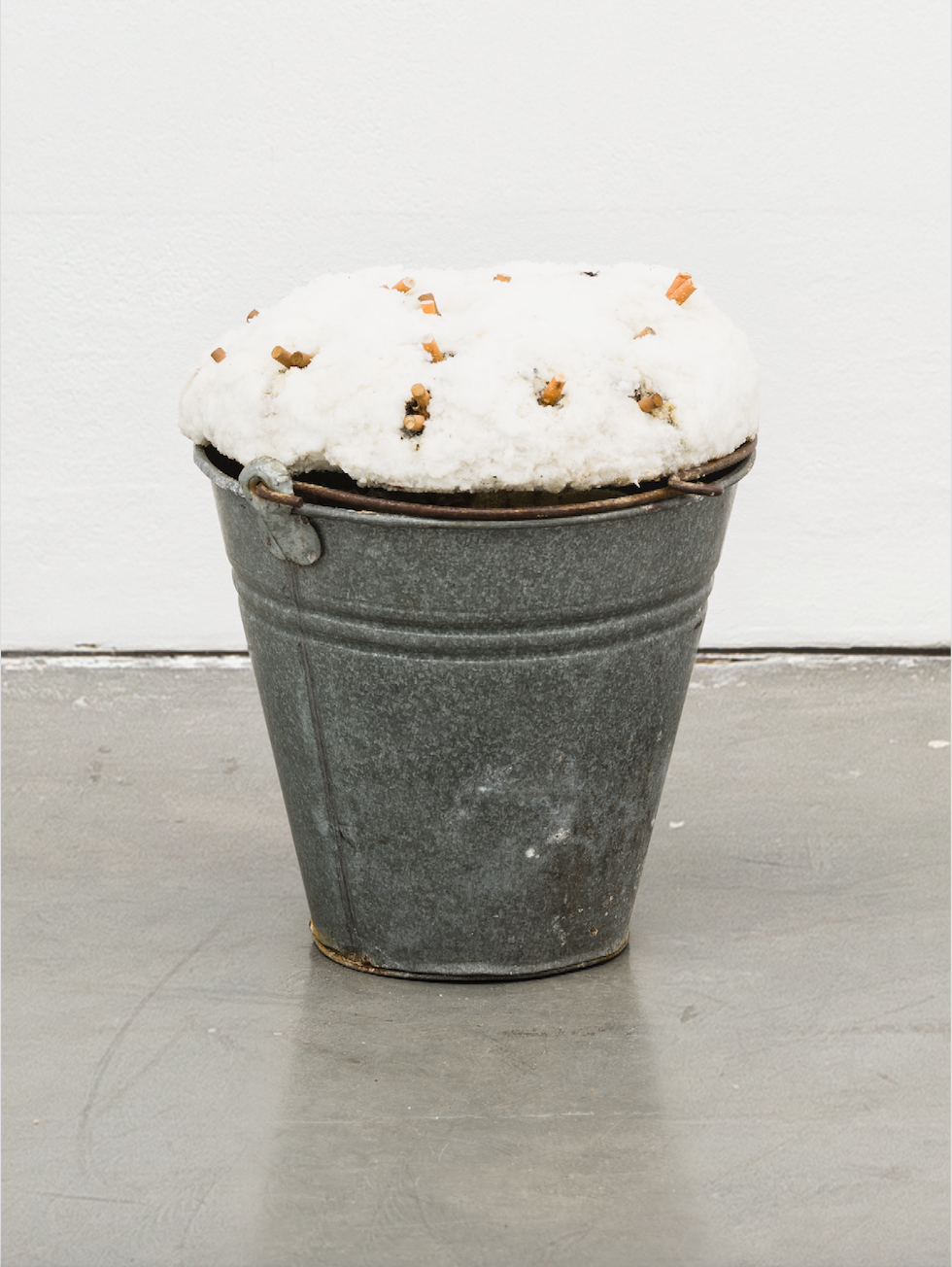IN REAL LIFE curated by_Luca Lo Pinto, MARIE MUL, Cigarette Hedgehog, 2012, Aluminium Eimer, Polyurethanschaum, Acrylfarbe, Lack, Cellophan, Zigaretten, 27 x 40 x 30 cm, Photo: Galerie Christine König, Vienna, 2014 Courtesy: Marie Mul und Galerie Christine König