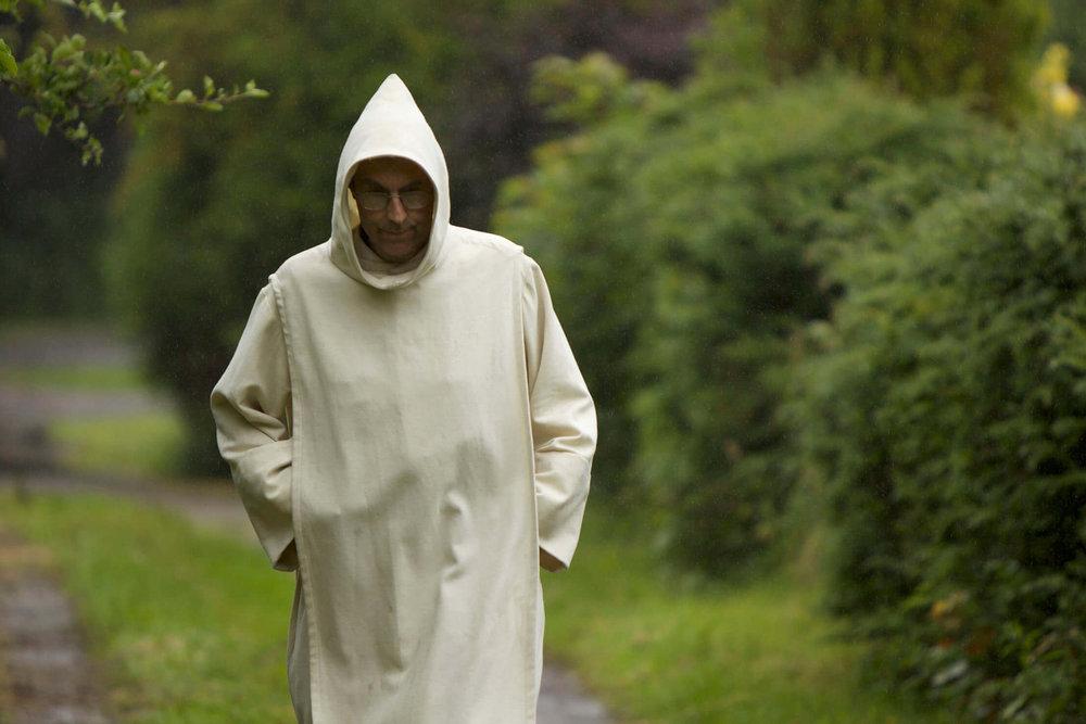 Father michael in pluscarden Abbey landscape.jpg