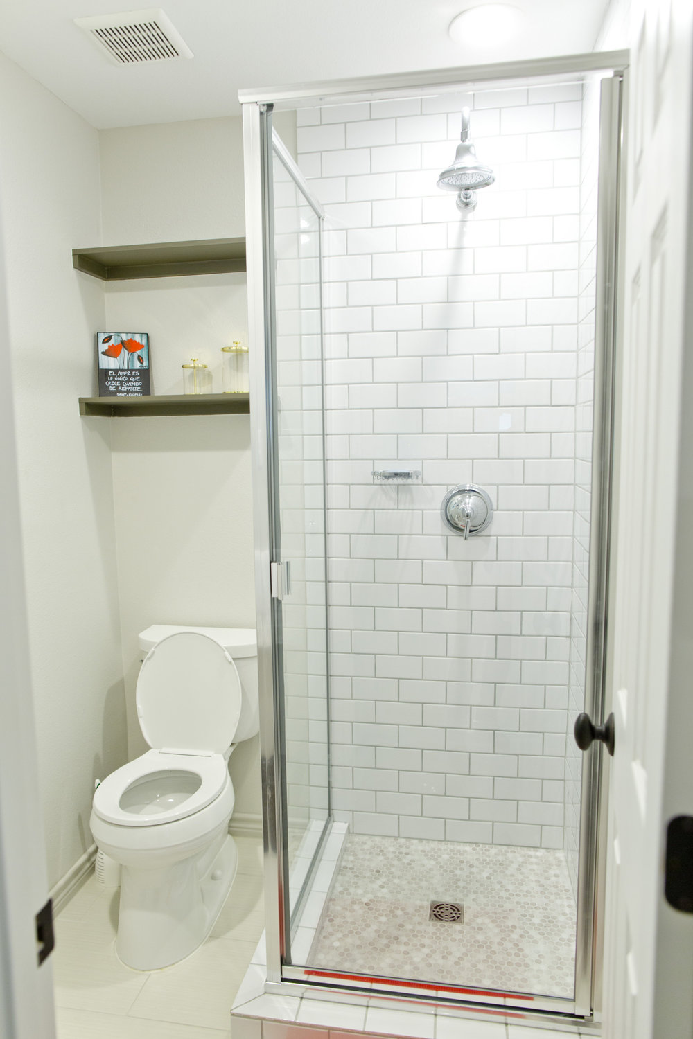 We maximized every space in creative ways, like adding a stand up shower off the laundry room so that guests staying in their upstairs room would have a full bathroom.