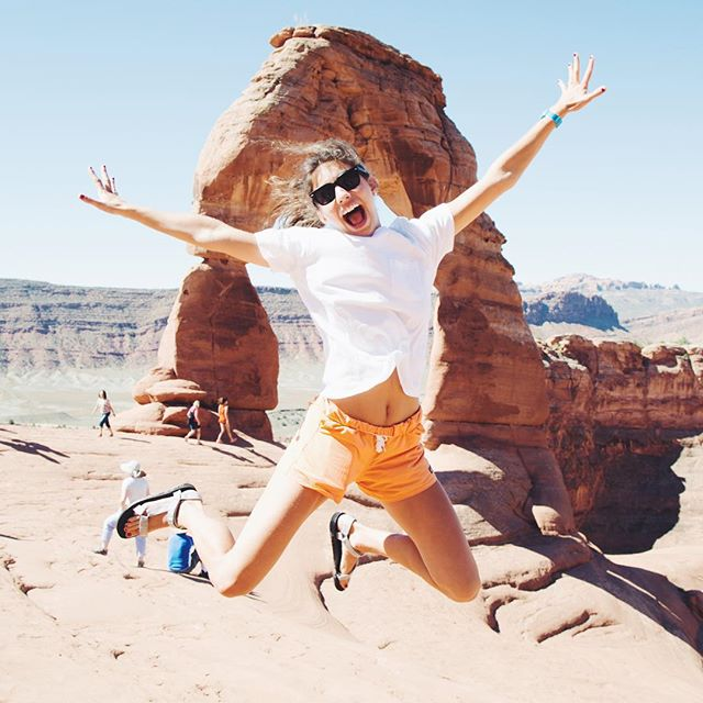 Lena jumps for joy in Arches National Park!