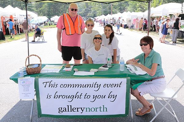 Volunteers help out during the 2014 annual Outdoor Art Show.