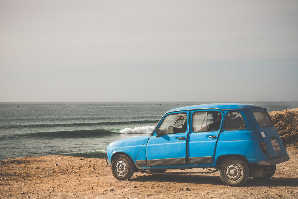 Old cars used by locals to check the surf at Taghazout