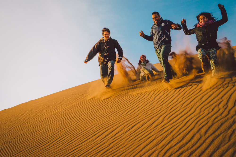 Running down sand dunes of the Sahara!