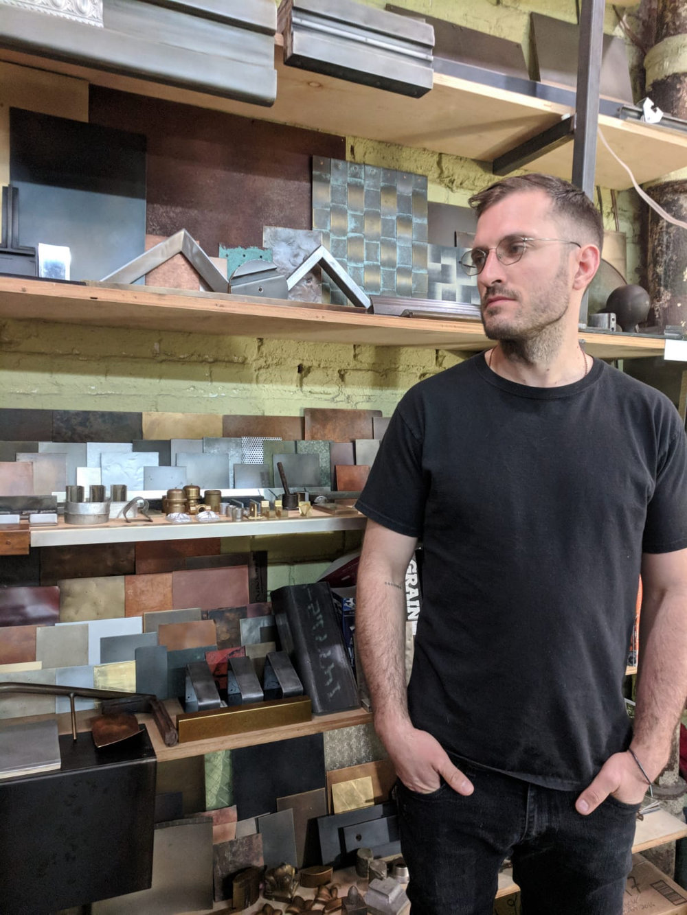 Andrew McNay in the studio, sample wall En.Zo Metal, 2018