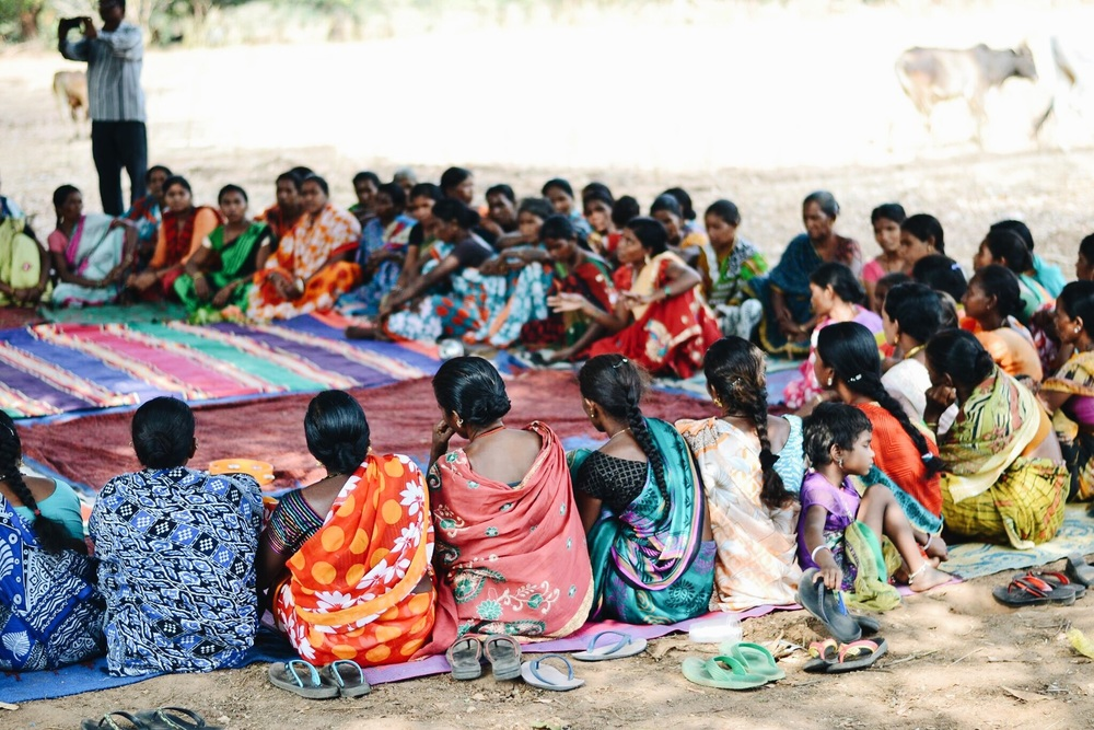 interacting with the women's self help groups in the village