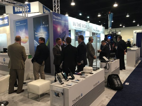 Thuraya Telecom's booth, featuring executives from SRT Wireless