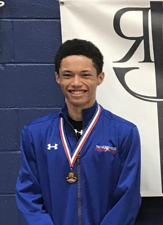Pictured: Nathan Andrews wears his Top-8 Medal in Junior Men's Foil