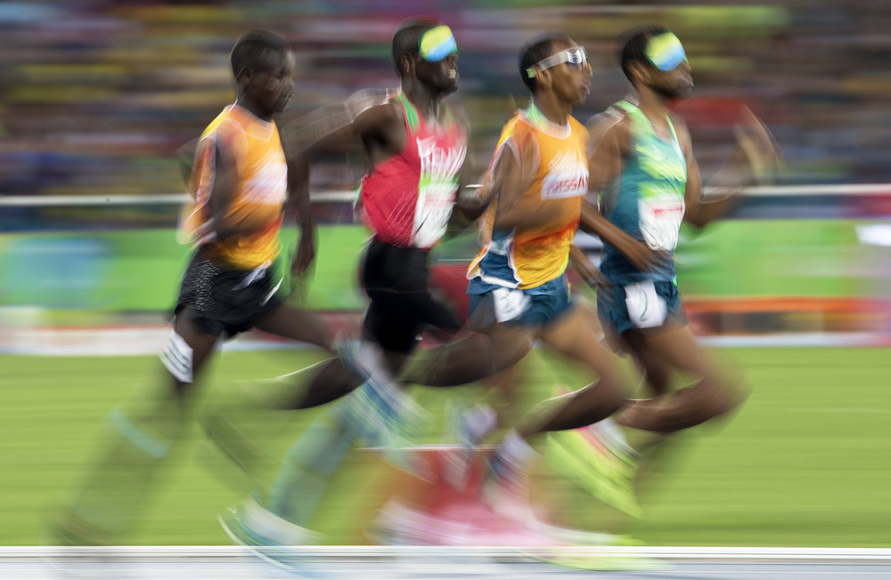Odair Santos, far right, and Samwel Mushai Kimani, second left, battle it out for gold during the men's 1500m final at the 2016 Paralympic Games in Rio de Janeiro, Brazil, on Tuesday, Sept. 13, 2016. Samwel Mushai Kimani and his guide James Boit won the race.