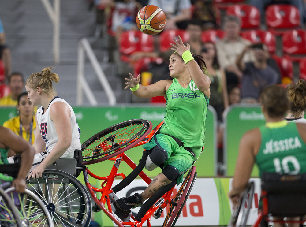 Brazil's Lia Martins takes a shot as she falls to the ground during Brazil's game against the U.S. in the women's wheelchair basketball quarter finals at the 2016 Paralympic Games in Rio de Janeiro, Brazil, on Tuesday, Sept. 13, 2016.