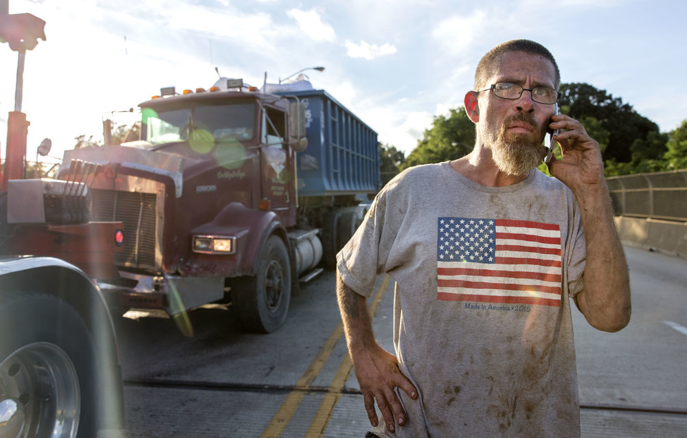 "Frank Beale, of Weston, W.Va., explains the situation with his boss after crashing into his lead man's truck on Tuesday, July 25, 2017 near the McKees Rocks Bridge. Beale was traveling from Aliquippa when he lost control of his truck. ""Coming down that hill, all that traffic, I couldn't get stopped. I hit my boss in front of me, the other truck that was with me. I was probably going about maybe ten, but I couldn't go more down fast enough to come to a stop sign. Driver error, I reckon. I should have been more alert,"" Beale says."