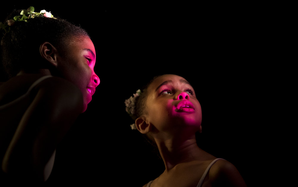 Ava Dominick, left, 10, and Neema Smith, 7, look at the stage light before getting ready for dress rehearsal with the Pittsburgh Ballet Theatre School in preparation for their May Spring Performance on Thursday, May 24, 2018 at the Byham Theater.