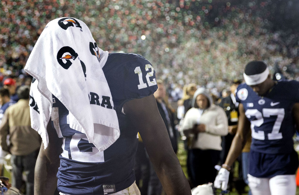 Chris Godwin walks off the field towards the locker room with a towel over his head after USC won the Rose Bowl game in Pasadena, CA on Monday, Jan. 2, 2017. USC beat Penn State 52-49.