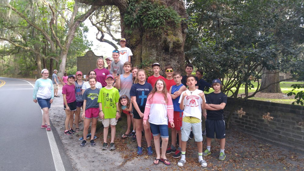 Group at the John Wesley Oak where islanders say the Rev. Wesley preached while in America.