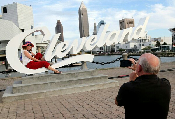 Visitors to Cleveland take in the skyline. A group of Cleveland boosters hopes to make the city a destination for art.