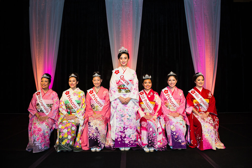 From left to right: Miss Congeniality Karly Misako Kanehiro, Princess Kylie Kimie Hisatake, Princess Kaydi Azure Hashima, Queen Melanie Camille Michiko Carrié, 1st Princess Mika Lyn Nakashige, Princess Chelsea Momoka Briggs, and Miss Popularity Shelby Keiko Wai'oluikamālie Meador.