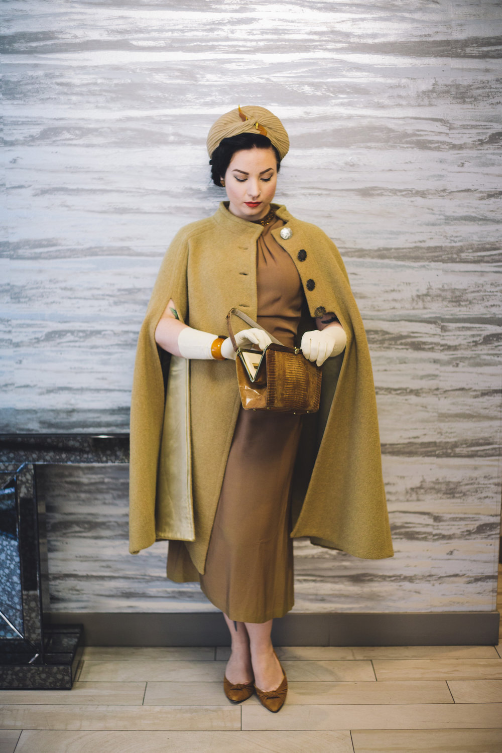 I did a little decade mixing here and there with this outfit. The turban, dress, and bag (lizard I think?) are all from the 40s. The cape and gloves are 60s, the shoes are 80s, and the celluloid hat pin is 30s. I LOVE the way they all go together.