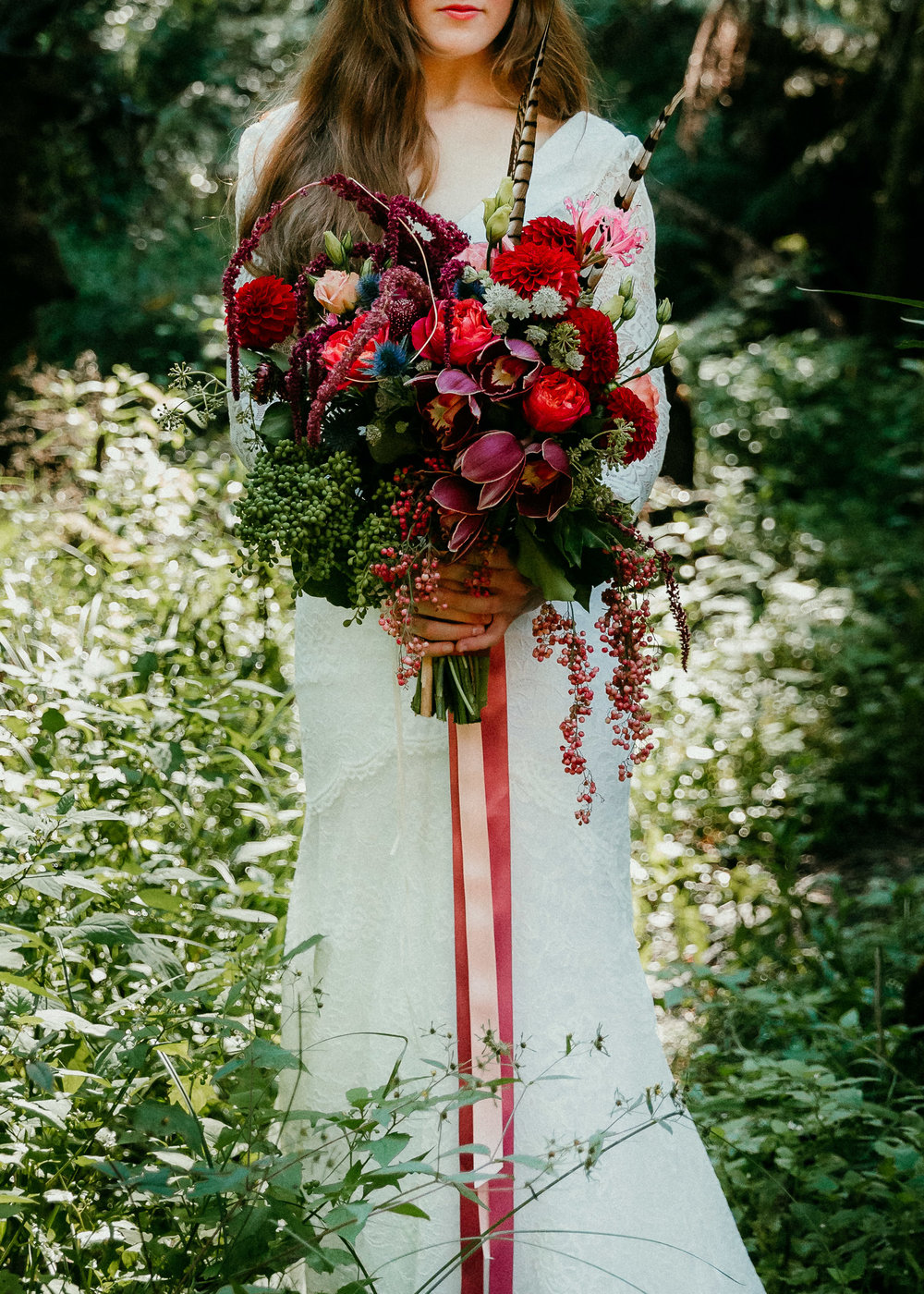 Floral-Bohemian-Bride-in-Lyrebird-Falls-with-colourful-flowers.jpg