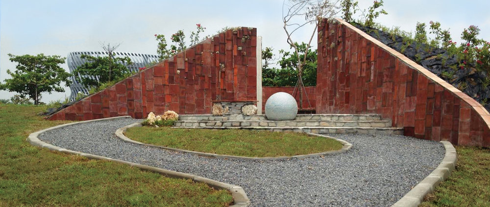 Twelve feet tall and covered in red clay bricks that come from one of the oldest kilns in the region, the structure at Pacific Birth invites visitors to journey to its center and see the shining pearl up close.