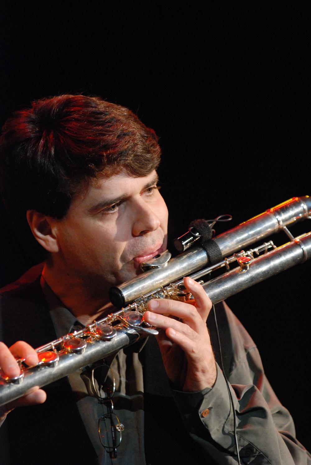 Mr. Brandão playing a bass flute.