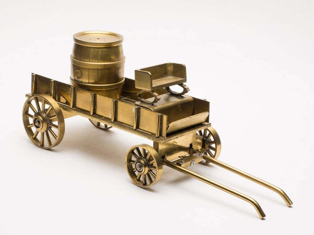 A wagon with a keg