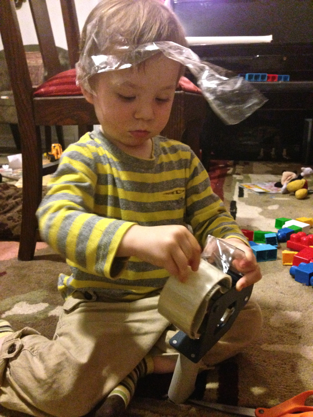 Finn playing with tape