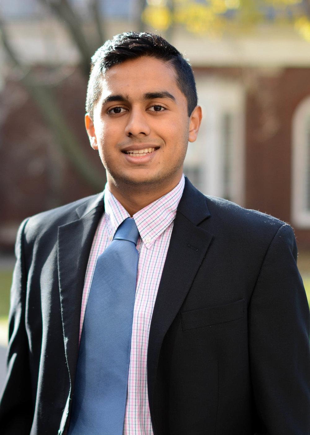 "RAAHUL ACHARYA '20 | MARKETING STRATEGIST - Raahul is a freshman living in Weld, who was born in sunny South India but raised outside of Atlanta, Georgia. He is considering concentrating in Economics with a secondary in Computer Science. Raahul is what you could call a ""die-hard"" sports fan, and follows his hometown Falcons and Hawks closely. Here at Harvard, he is a member of the competitive club tennis team, with tennis being another one of his athletic pursuits. He is currently a member of the Harvard Financial Analysts Club, South Asian Association, and College Bhangra Team as well. When he isn't inundated by school work or extracurricular activities, Raahul can be found reading or watching classic movies."