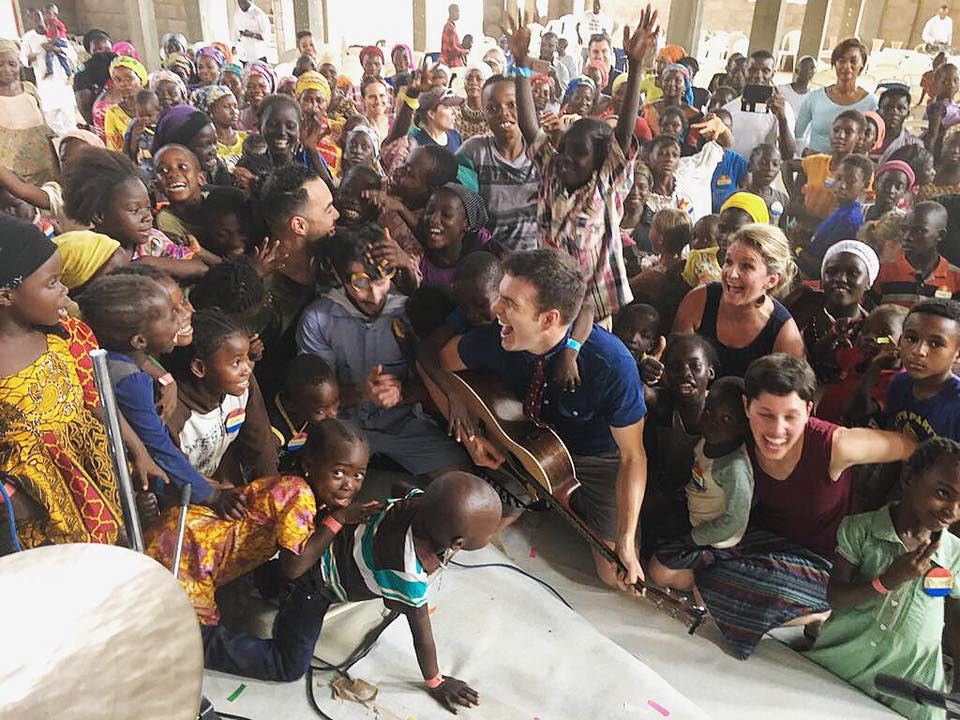 As a visiting artist through the United States' cultural exchange program, the highlight of Tim's 2018 has been a two week tour through Nigeria. Here him and his band make music with the children of IDP camp outside of Abuja.