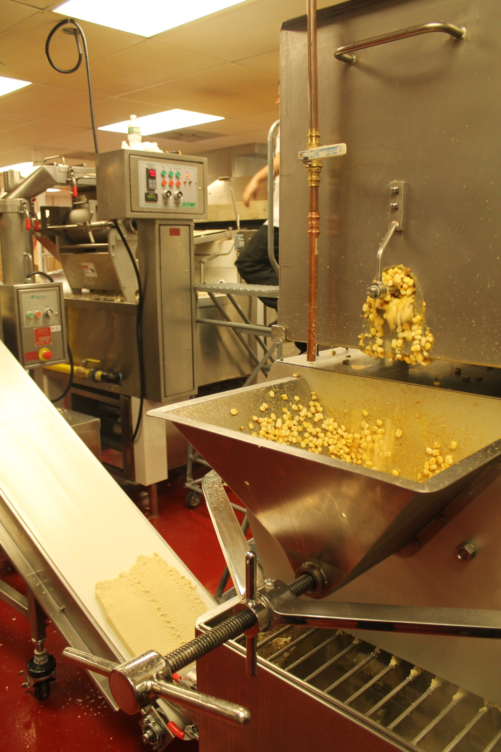 The corn is ground into masa.