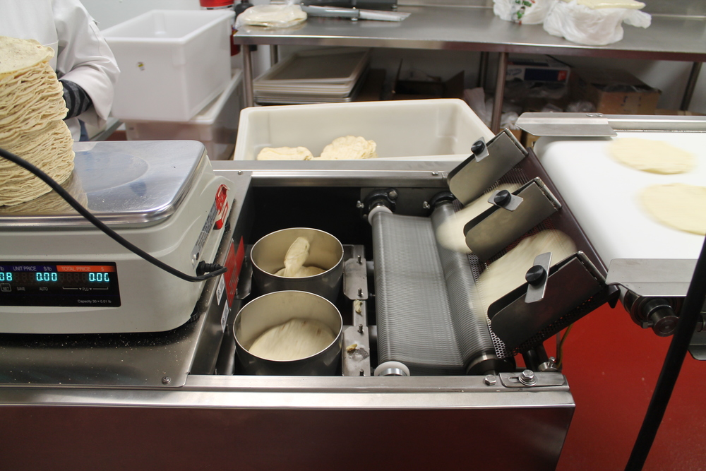 Sorting and stacking tortillas, fresh from the oven