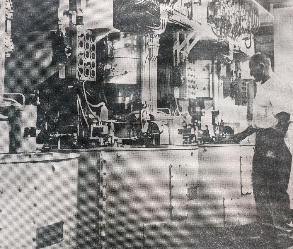 1965 - John strohauer watching over a centrifugal-force machine that separates wet sugar from molasses in the sugar beet factory.