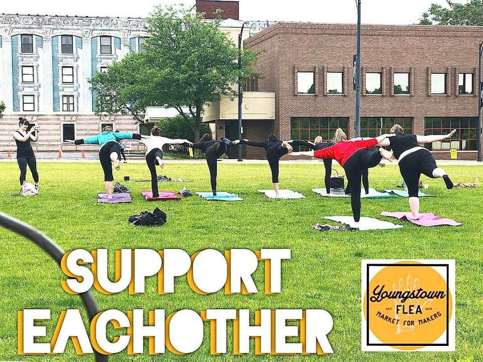 Melissa of Kindred Collection instructing the class to lean on each other during Yoga at the Flea!