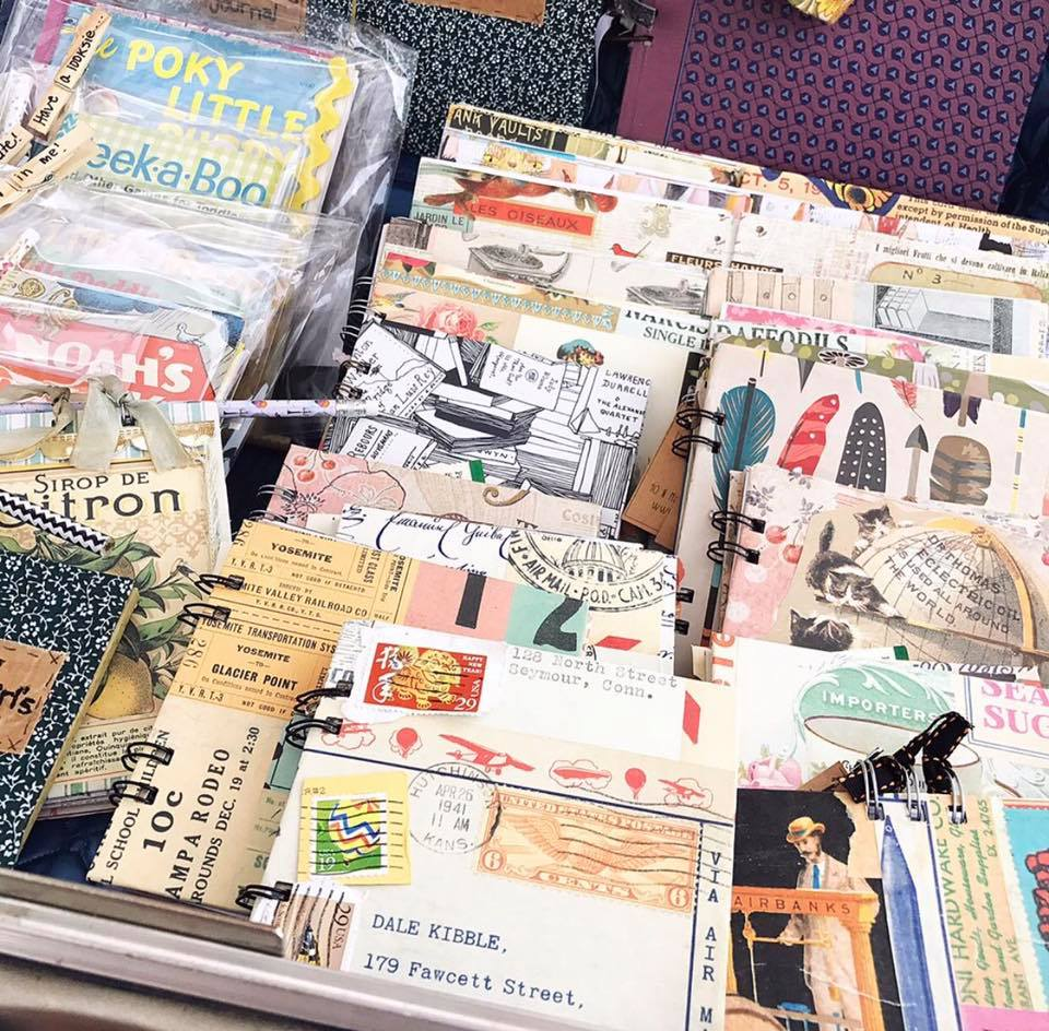 These are all books I have made. Some of the covers are from decorative papers and others are vintage wrapping paper. I added some vintage stamps to the outside, while the inside is a mix of scrapbook paper and vintage book pages. You're own book can be personalized with your own memories.