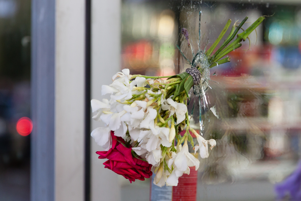 Flowers placed in the bullet hole at the site of the shooting