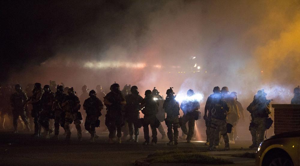 Riot police in Ferguson (via  Slate )