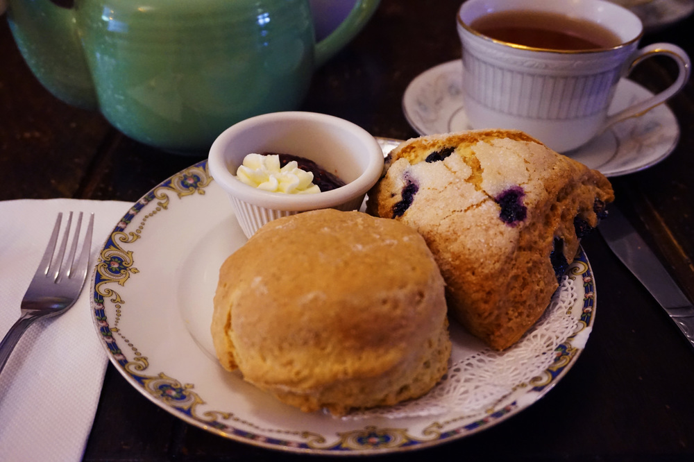A special blend of jasmine, green, and floral tea accompanied by scones and jam + clotted cream ~drool~