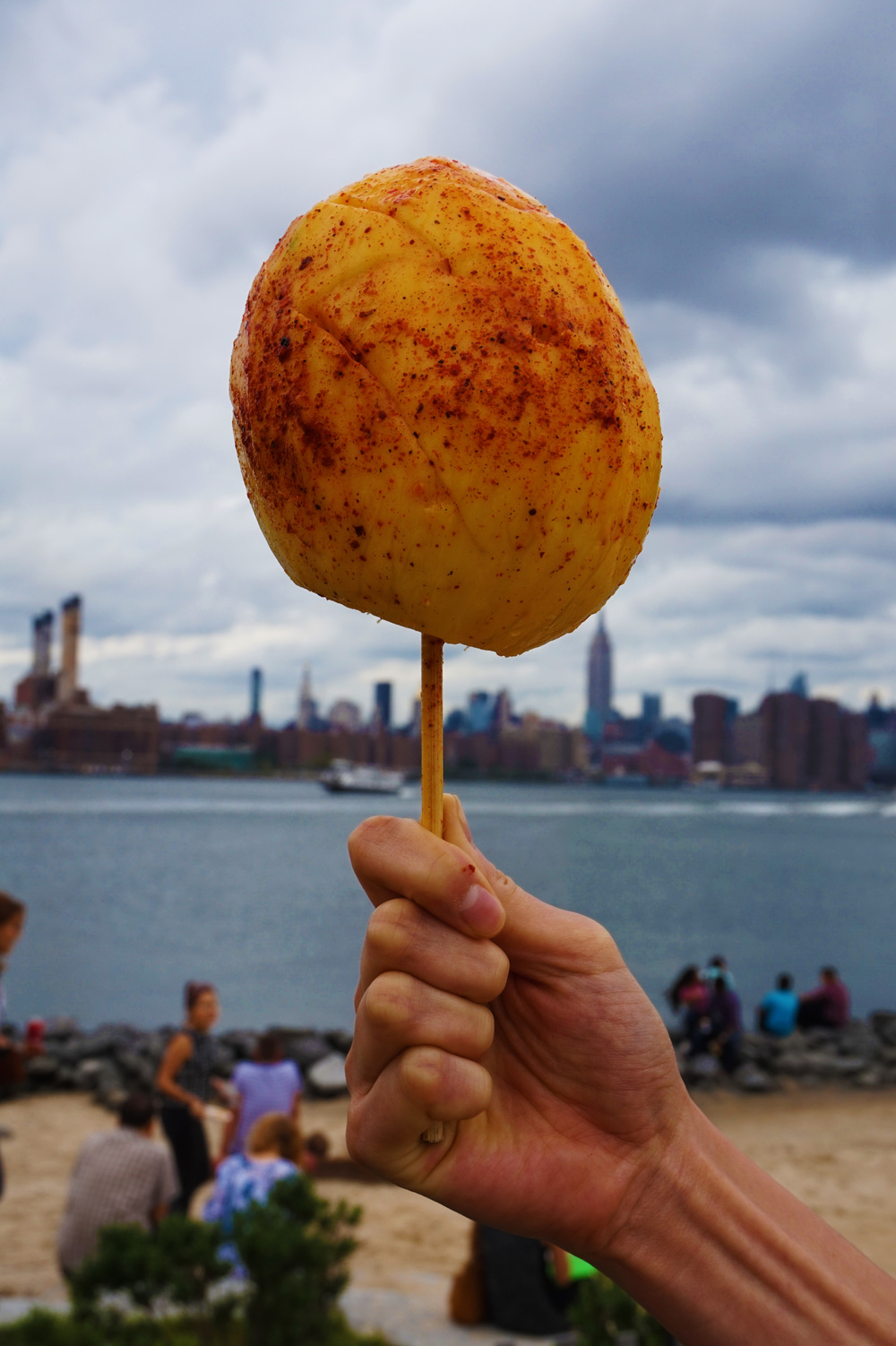 """Wait, we have to take a picture of the mango with the skyline in the background"""
