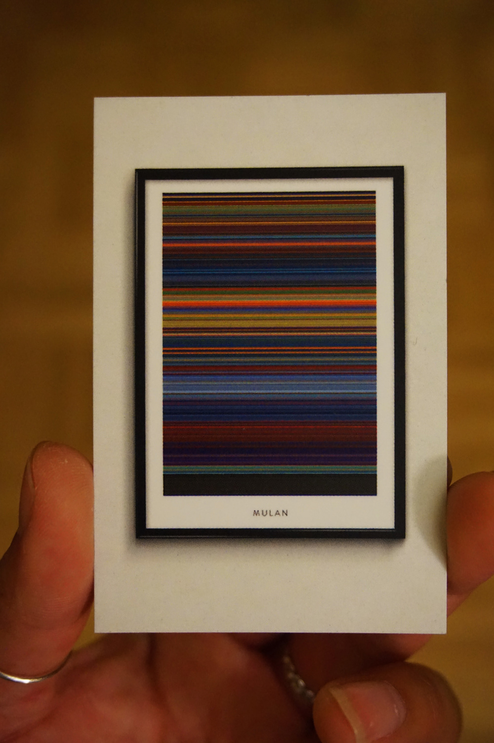 Little movie posters made from every scene in the movie represented by a color