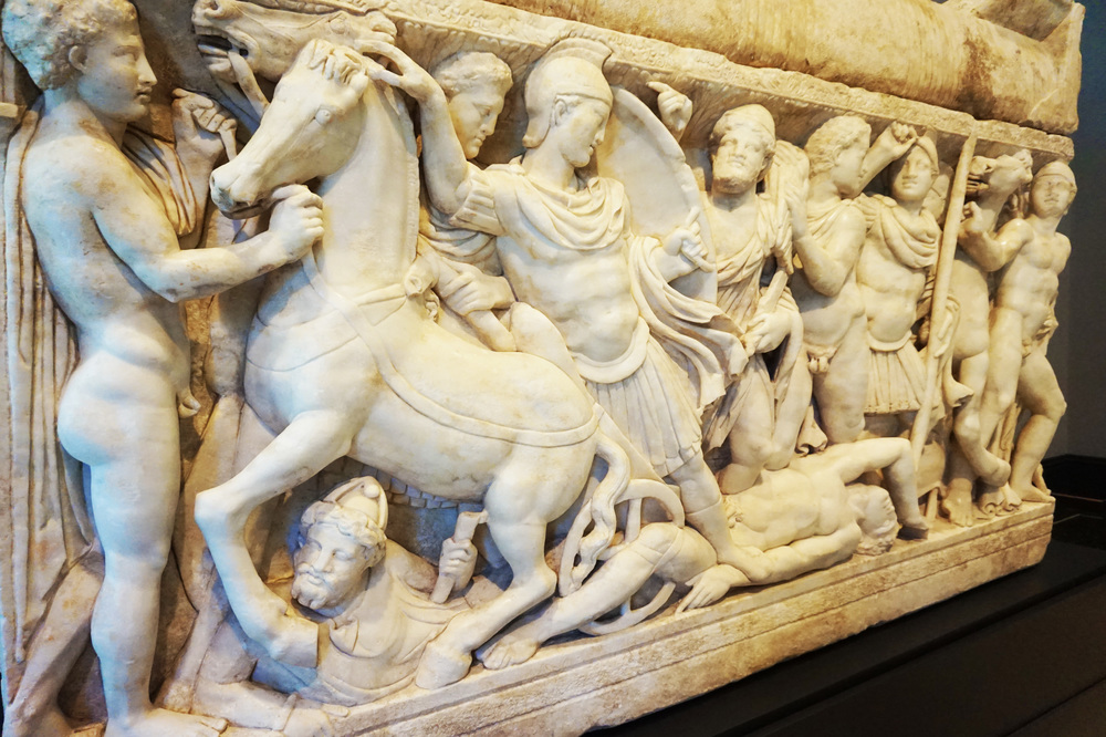 A sarcophagus carved with a Roman battle scene