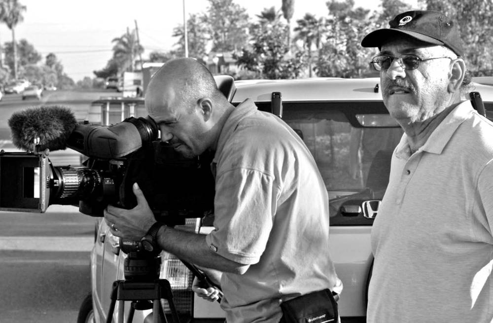 Paul Espinosa (right) directs cinematographer Howard Shack on the shoot for The American Dream series.