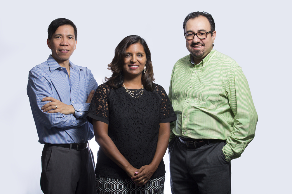 """Archana J. McEligot, professor of health science at Cal State Fullerton, is directing the National Institutes of Health-funded """"big data"""" science program in collaboration with Sam Behseta, right, CSUF professor of mathematics, and Math P. Cuajungco, CSUF associate professor of biological science."""