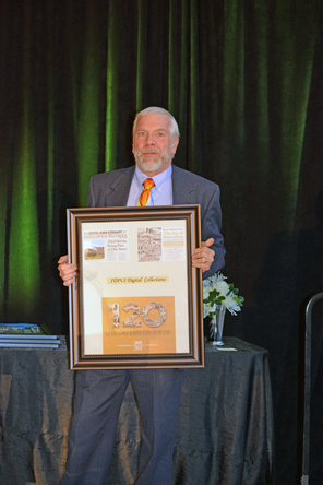 Dean David W. Lewis accepted the Indianapolis Recorder award.